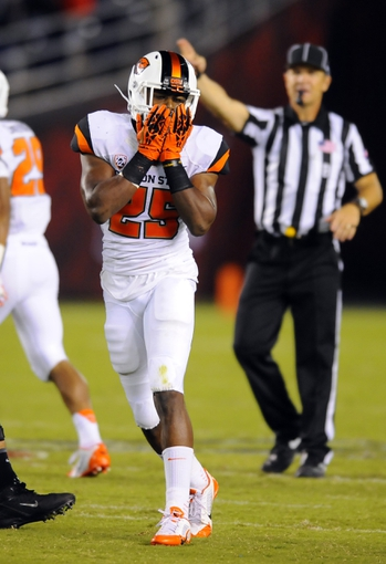 Sep 21, 2013; San Diego, CA, USA; Oregon State Beavers safety Ryan Murphy (25) reacts after an interception in the closing minutes of the second half against the San Diego State Aztecs at Qualcomm Stadium. Mandatory Credit: Christopher Hanewinckel-USA TODAY Sports