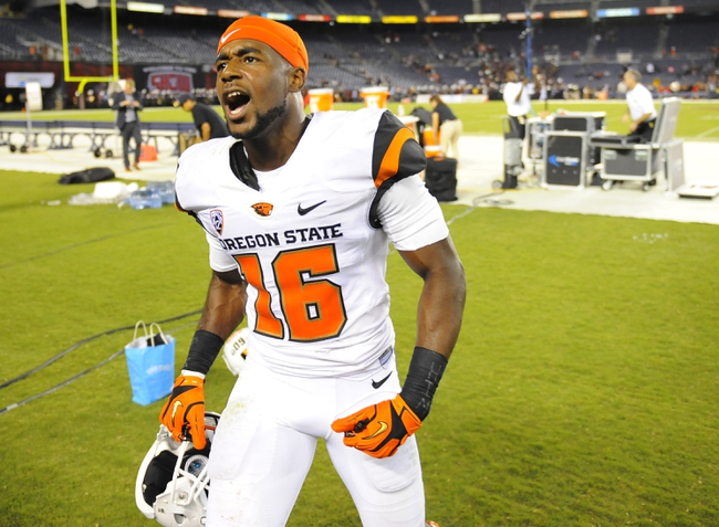 Sep 21, 2013; San Diego, CA, USA; Oregon State cornerback Rashaad Reynolds (16) celebrates after a 34-30 win against the San Diego State Aztecs at Qualcomm Stadium. Mandatory Credit: Christopher Hanewinckel-USA TODAY Sports