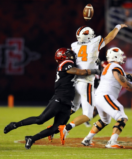 zzzSep 21, 2013; San Diego, CA, USA; Oregon State Beavers quarterback Sean Mannion (4) has the ball knocked out by San Diego State Aztecs linebacker Josh Gavert (48) during the second half at Qualcomm Stadium. Mandatory Credit: Christopher Hanewinckel-USA TODAY Sports