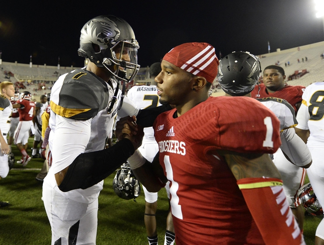 Sep 21, 2013; Bloomington, IN, USA; Missouri Tigers quarterback James Franklin (1) shakes hands with Indiana Hoosiers wide receiver Shane Wynn (1) after the game at Memorial Stadium. Missouri defeats Indiana 45-28. Mandatory Credit: Mike DiNovo-USA TODAY Sports