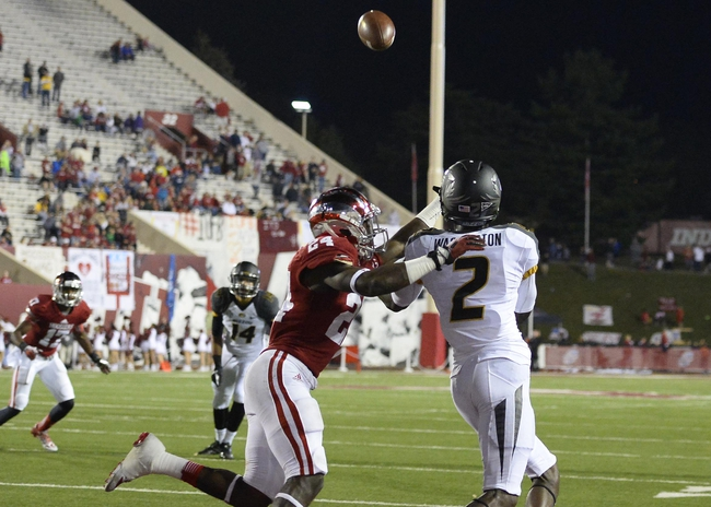 Sep 21, 2013; Bloomington, IN, USA; Missouri Tigers wide receiver L'Damian Washington (2) makes a touchdown catch against Indiana Hoosiers cornerback Tim Bennett (24) during the second half at Memorial Stadium. Missouri defeats Indiana 45-28. Mandatory Credit: Mike DiNovo-USA TODAY Sports