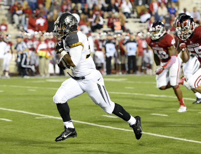 Sep 21, 2013; Bloomington, IN, USA; Missouri Tigers running back Russell Hansbrough (32) rushes for a touchdown against the Indiana Hoosiers during the second half at Memorial Stadium. Missouri defeats Indiana 45-28. Mandatory Credit: Mike DiNovo-USA TODAY Sports