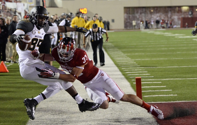 Sep 21, 2013; Bloomington, IN, USA; Missouri Tigers wide receiver Marcus Lucas (85) makes a catch against Indiana Hoosiers safety Mark Murphy (37) but is ruled out of bounds during the second half at Memorial Stadium. Missouri defeats Indiana 45-28. Mandatory Credit: Mike DiNovo-USA TODAY Sports