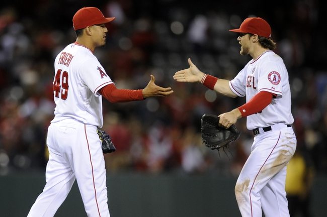 Sep 21, 2013; Anaheim, CA, USA; Los Angeles Angels pitcher Ernesto Frieri (49) and second baseman Grant Green (10) celebrate after the game against the Seattle Mariners at Angel Stadium of Anaheim. The Los Angeles Angels defeated the Seattle Mariners 6-5. Mandatory Credit: Kelvin Kuo-USA TODAY Sports
