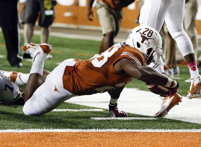 Sep 21, 2013; Austin, TX, USA; Texas Longhorns running back Malcolm Brown (28) runs to the one yard line against Kansas State Wildcats defensive back Kip Daily (7) during the fourth quarter of a football game at Darrell K Royal-Texas Memorial Stadium. The Longhorns won 31-21. Mandatory Credit: Jim Cowsert-USA TODAY Sports