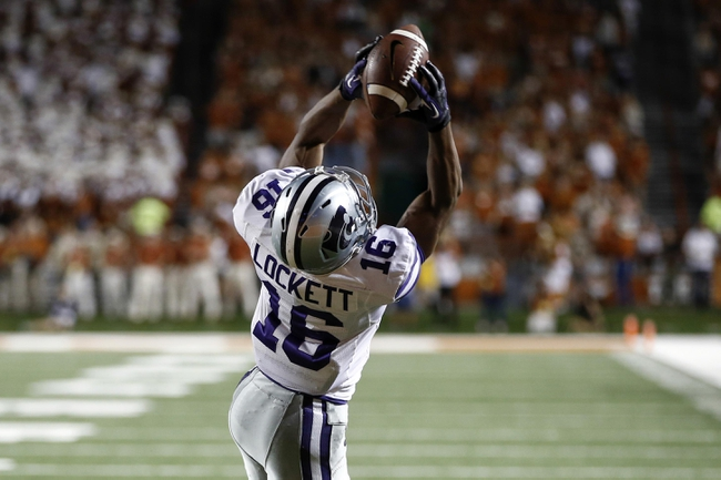 Sep 21, 2013; Austin, TX, USA; Kansas State Wildcats wide receiver Tyler Lockett (16) makes a catch to the one yard line against the Texas Longhorns during the fourth quarter of a football game at Darrell K Royal-Texas Memorial Stadium. The Longhorns won 31-21. Mandatory Credit: Jim Cowsert-USA TODAY Sports