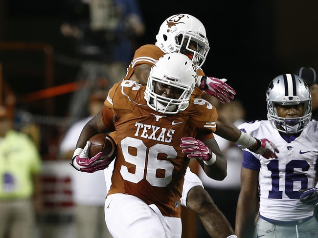 Sep 21, 2013; Austin, TX, USA; Texas Longhorns defensive tackle Chris Whaley (96) and cornerback Carrington Byndom (23) celebrate Whaley's fumble recovery against the Kansas State Wildcats during the fourth quarter of a football game at Darrell K Royal-Texas Memorial Stadium. The Longhorns won 31-21. Mandatory Credit: Jim Cowsert-USA TODAY Sports