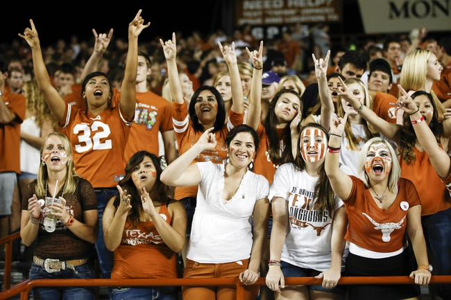 Sep 21, 2013; Austin, TX, USA; Texas Longhorns fans celebrate during the fourth quarter against the Kansas State Wildcats of a football game at Darrell K Royal-Texas Memorial Stadium. The Longhorns won 31-21. Mandatory Credit: Jim Cowsert-USA TODAY Sports