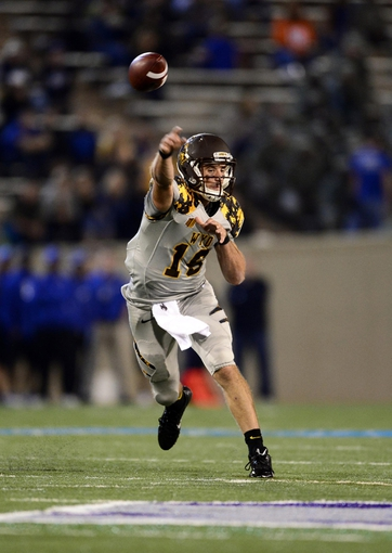 Sep 21, 2013; Colorado Springs, CO, USA; Wyoming Cowboys quarterback Brett Smith (16) passes against the Air Force Falcons in the second quarter at Falcon Stadium. Mandatory Credit: Ron Chenoy-USA TODAY Sports