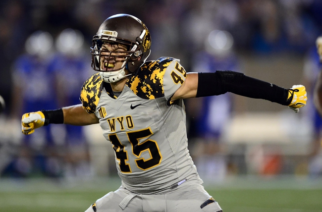 Sep 21, 2013; Colorado Springs, CO, USA; Wyoming Cowboys quarterback Brett Smith (16) reacts after a turnover on downs against the Air Force Falcons in the first quarter at Falcon Stadium. Mandatory Credit: Ron Chenoy-USA TODAY Sports