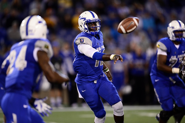 Sep 21, 2013; Colorado Springs, CO, USA; Air Force Falcons quarterback Jaleel Awini (12) pitches the football to running back Jon Lee (24) against the Wyoming Cowboys in the second quarter at Falcon Stadium. Mandatory Credit: Ron Chenoy-USA TODAY Sports