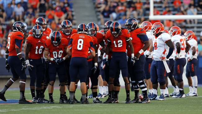 Sep 21, 2013; El Paso, TX, USA; UTSA Roadrunners offense huddles up for a play against the UTEP Miners defense during the first half at Sun Bowl Stadium. The Roadrunners defeated the Miners 32-13. Mandatory Credit: Ivan Pierre Aguirre-USA TODAY Sports