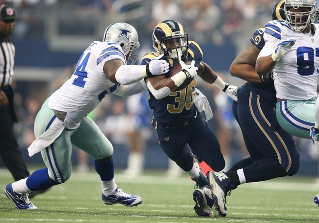 Sep 22, 2013; Arlington, TX, USA; St. Louis Rams running back Benny Cunningham (36) is tackled by Dallas Cowboys defensive end DeMarcus Ware (94) in the first quarter at AT&T Stadium. Mandatory Credit: Matthew Emmons-USA TODAY Sports