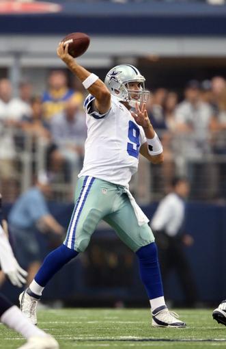 Sep 22, 2013; Arlington, TX, USA; Dallas Cowboys quarterback Tony Romo (9) throws in the pocket against the St. Louis Rams at AT&T Stadium. Mandatory Credit: Matthew Emmons-USA TODAY Sports