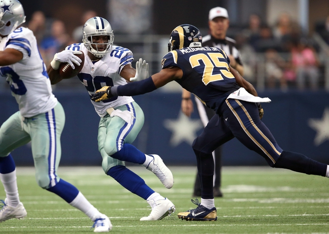 Sep 22, 2013; Arlington, TX, USA; Dallas Cowboys running back DeMarco Murray (29) runs with the ball against St. Louis Rams safety T.J. McDonald (25) at AT&T Stadium. Mandatory Credit: Matthew Emmons-USA TODAY Sports