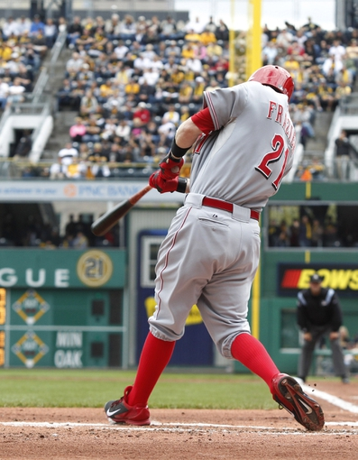 Sep 22, 2013; Pittsburgh, PA, USA; Cincinnati Reds third baseman Todd Frazier (21) hits a two-run home run against the Pittsburgh Pirates during the first inning at PNC Park. Mandatory Credit: Charles LeClaire-USA TODAY Sports