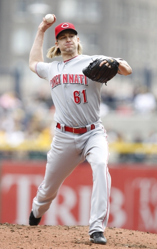 Sep 22, 2013; Pittsburgh, PA, USA; Cincinnati Reds starting pitcher Bronson Arroyo (61) pitches against the Pittsburgh Pirates during the first inning at PNC Park. Mandatory Credit: Charles LeClaire-USA TODAY Sports