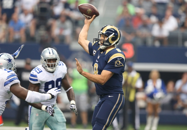 Sep 22, 2013; Arlington, TX, USA; St. Louis Rams quarterback Sam Bradford (8) throws under pressure from Dallas Cowboys defensive end George Selvie and DeMarcus Ware (94) at AT&T Stadium. The Dallas Cowboys beat St. Louis Rams 31-7. Mandatory Credit: Matthew Emmons-USA TODAY Sports