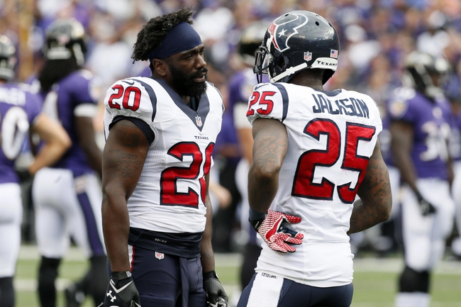 Sep 22, 2013; Baltimore, MD, USA; Houston Texans safety Ed Reed (20) talks with cornerback Kareem Jackson (25) during the game against the Baltimore Ravens at M&T Bank Stadium. Mandatory Credit: Mitch Stringer-USA TODAY Sports