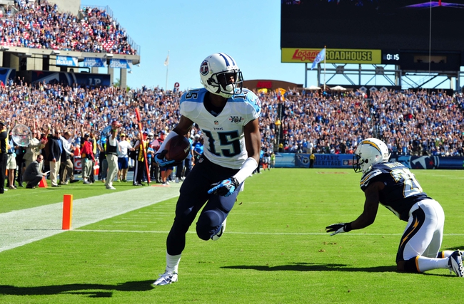Sep 22, 2013; Nashville, TN, USA; Tennessee Titans wide receiver Justin Hunter (15) scores the winning touchdown against San Diego Chargers cornerback Crezdon Butler (20) during the second half at LP Field. The Titans beat the Chargers 20-17. Mandatory Credit: Don McPeak-USA TODAY Sports