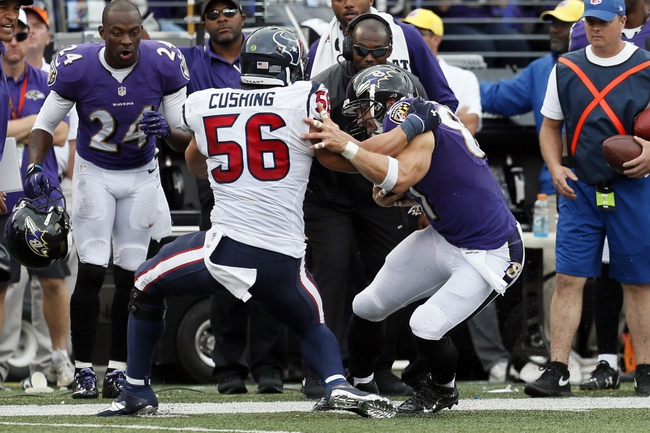 Sep 22, 2013; Baltimore, MD, USA; Houston Texans linebacker Brian Cushing (56) tackles Baltimore Ravens tight end Dallas Clark (87) following his catch at M&T Bank Stadium. Mandatory Credit: Mitch Stringer-USA TODAY Sports