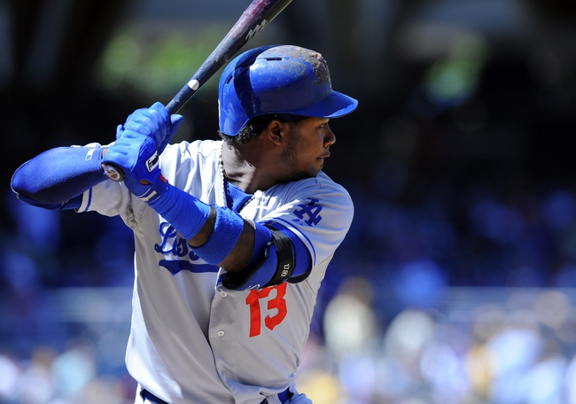 Sep 22, 2013; San Diego, CA, USA; Los Angeles Dodgers shortstop Hanley Ramirez (13) during an at bat in the first inning against the San Diego Padres at Petco Park. Mandatory Credit: Christopher Hanewinckel-USA TODAY Sports