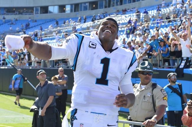 Sep 22, 2013; Charlotte, NC, USA; Carolina Panthers quarterback Cam Newton (1) reacts leaving the field after the game. The Carolina Panthers defeated the New York Giants 38-0 at Bank of America Stadium. Mandatory Credit: Bob Donnan-USA TODAY Sports