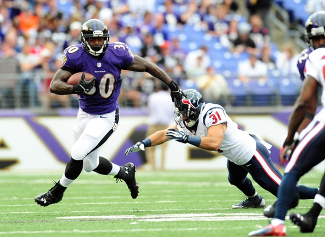 Sep 22, 2013; Baltimore, MD, USA; Baltimore Ravens running back Bernard Pierce (30) avoids the tackle of Houston Texans safety Shiloh Keo (31) during the game at M&T Bank Stadium. Mandatory Credit: Evan Habeeb-USA TODAY Sports
