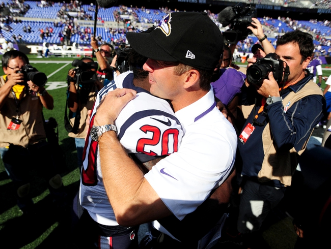 Sep 22, 2013; Baltimore, MD, USA; Baltimore Ravens head coach John Harbaugh (right) shakes hands with Houston Texans safety Ed Reed (left) after the game at M&T Bank Stadium. Mandatory Credit: Evan Habeeb-USA TODAY Sports