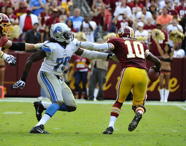 Sep 22, 2013; Landover, MD, USA; Detroit Lions defensive end Willie Young (79) pressures Washington Redskins quarterback Robert Griffin III (10) during the second half at FedEX Field. The Lions won 27 - 20. Mandatory Credit: Brad Mills-USA TODAY Sports