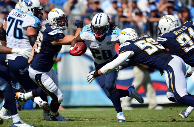 Sep 22, 2013; Nashville, TN, USA; Tennessee Titans running back Chris Johnson (28) carries the ball against the San Diego Chargers during the second half at LP Field. The Titans beat the Chargers 20-17. Mandatory Credit: Don McPeak-USA TODAY Sports