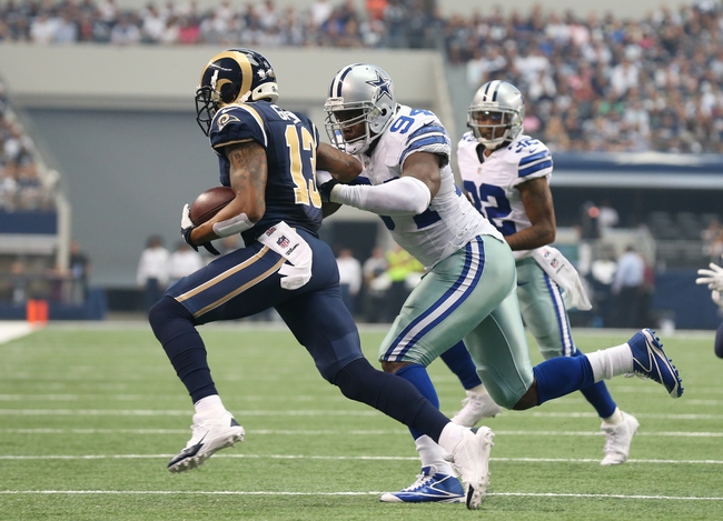 Sep 22, 2013; Arlington, TX, USA; St. Louis Rams receiver Chris Givens (13) is tackled by Dallas Cowboys defensive end DeMarcus Ware (94) at AT&T Stadium. Mandatory Credit: Matthew Emmons-USA TODAY Sports