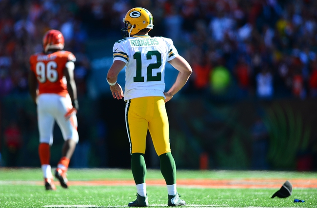Sep 22, 2013; Cincinnati, OH, USA; Green Bay Packers quarterback Aaron Rodgers (12) reacts after after a fumble during the fourth quarter at Paul Brown Stadium. Mandatory Credit: Andrew Weber-USA TODAY Sports