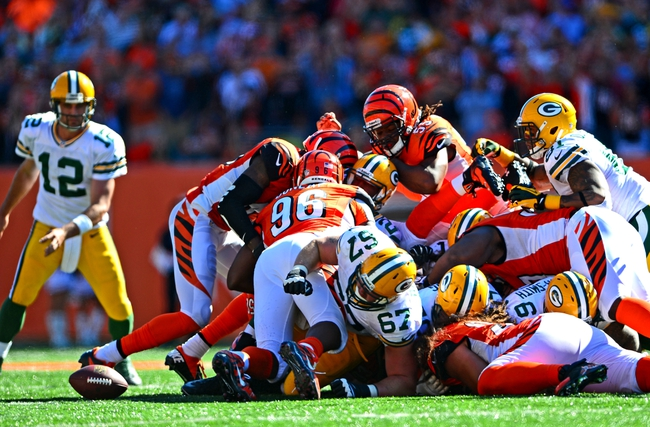 Sep 22, 2013; Cincinnati, OH, USA; A fumble by the Green Bay Packers during the fourth quarter against the Cincinnati Bengals at Paul Brown Stadium. Mandatory Credit: Andrew Weber-USA TODAY Sports