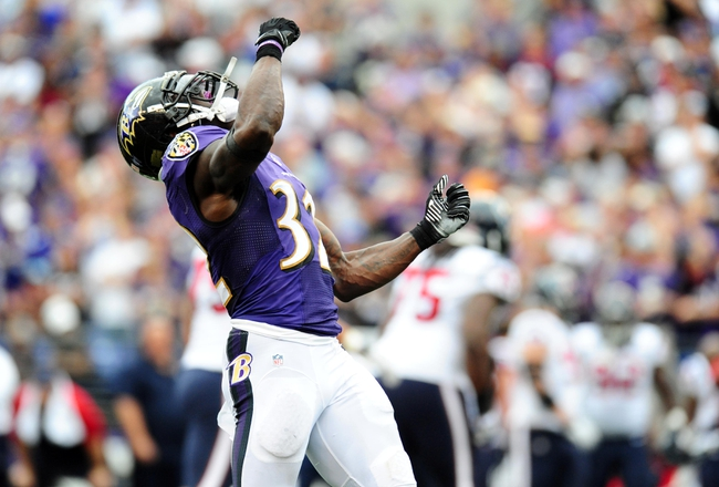 Sep 22, 2013; Baltimore, MD, USA; Baltimore Ravens safety James Ihedigbo (32) celebrates after making a stop in the fourth quarter against the Houston Texans at M&T Bank Stadium. Mandatory Credit: Evan Habeeb-USA TODAY Sports