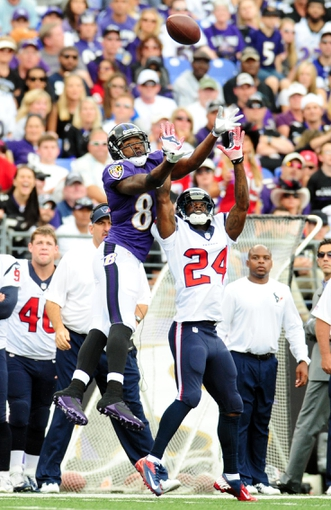 Sep 22, 2013; Baltimore, MD, USA; Houston Texans cornerback Johnathan Joseph (24) knocks the pass away from Baltimore Ravens wide receiver Torrey Smith (82) at M&T Bank Stadium. Mandatory Credit: Evan Habeeb-USA TODAY Sports