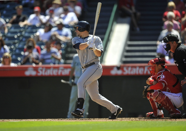 September 22, 2013; Anaheim, CA, USA; Seattle Mariners catcher Mike Zunino (3) hits an RBI double during the second inning against the Los Angeles Angels at Angel Stadium of Anaheim. Mandatory Credit: Gary A. Vasquez-USA TODAY Sports