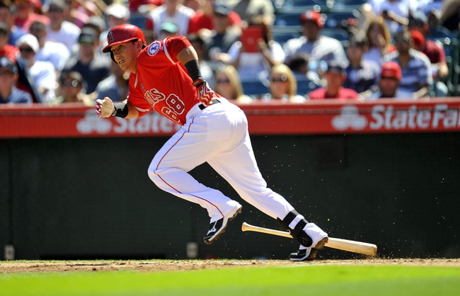 September 22, 2013; Anaheim, CA, USA; Los Angeles Angels first baseman Efren Navarro (68) hits an RBI single during the second inning against the Seattle Mariners at Angel Stadium of Anaheim. Mandatory Credit: Gary A. Vasquez-USA TODAY Sports