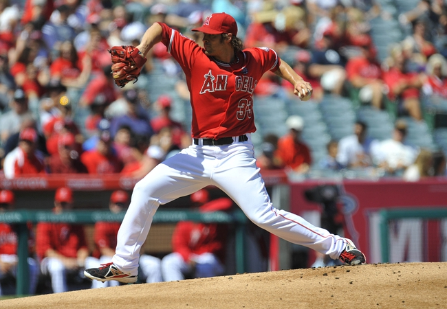 September 22, 2013; Anaheim, CA, USA; Los Angeles Angels starting pitcher C.J. Wilson (33) pitches during the first inning against the Seattle Mariners at Angel Stadium of Anaheim. Mandatory Credit: Gary A. Vasquez-USA TODAY Sports