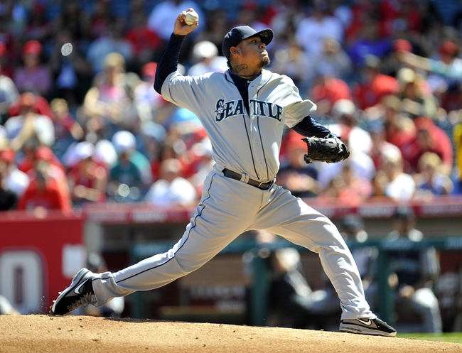 September 22, 2013; Anaheim, CA, USA; Seattle Mariners starting pitcher Felix Hernandez (34) pitches during the first inning against the Los Angeles Angels at Angel Stadium of Anaheim. Mandatory Credit: Gary A. Vasquez-USA TODAY Sports