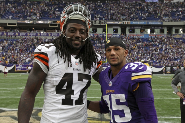 Sep 22, 2013; Minneapolis, MN, USA; Cleveland Browns tight end MarQueis Gray (47) and Minnesota Vikings cornerback Marcus Sherels (35) pose for a photo following the game at Mall of America Field at H.H.H. Metrodome. The Browns defeated the Vikings 31-27. Mandatory Credit: Brace Hemmelgarn-USA TODAY Sports