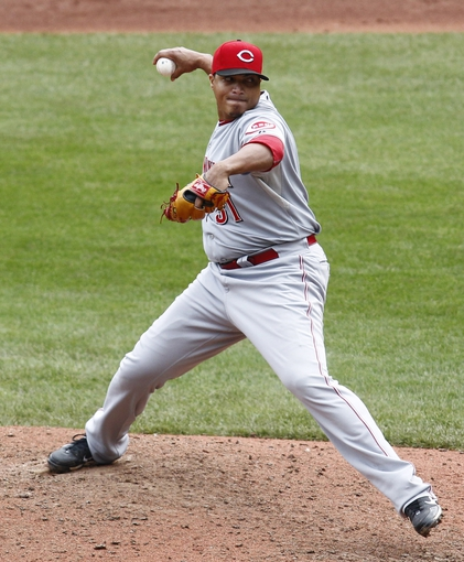 Sep 22, 2013; Pittsburgh, PA, USA; Cincinnati Reds relief pitcher Alfredo Simon (31) pitches against the Pittsburgh Pirates during the seventh inning at PNC Park. The Reds won 11-3. Mandatory Credit: Charles LeClaire-USA TODAY Sports