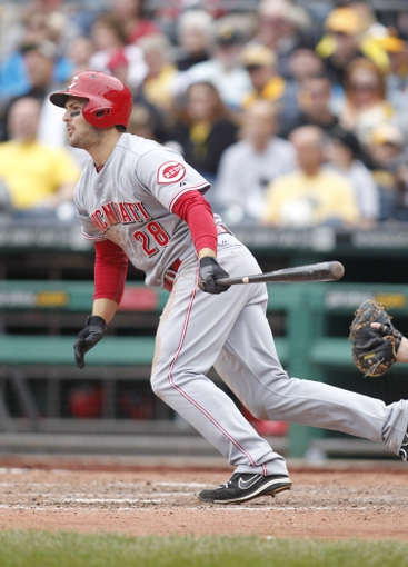 Sep 22, 2013; Pittsburgh, PA, USA; Cincinnati Reds left fielder Chris Heisey (28) hits an RBI single against the Pittsburgh Pirates during the eighth inning at PNC Park.  The Reds won 11-3. Mandatory Credit: Charles LeClaire-USA TODAY Sports