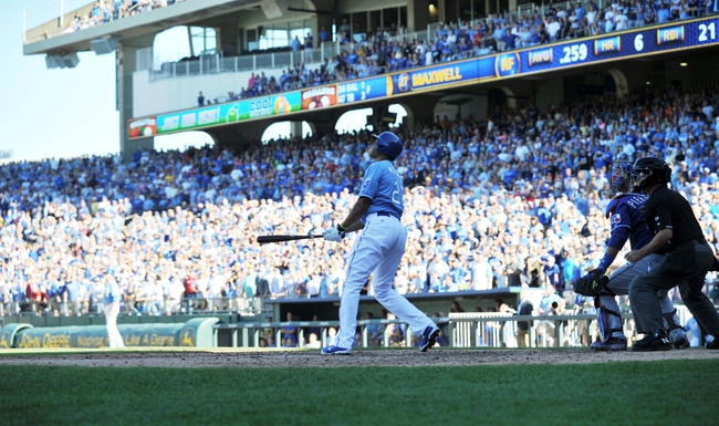 Sep 22, 2013; Kansas City, MO, USA; Kansas City Royals right fielder Justin Maxwell (27) hits a walk off grand slam against the Texas Rangers during the 10th inning at Kauffman Stadium. The Royals beat the Rangers 4-0. Mandatory Credit: Peter G. Aiken-USA TODAY Sports