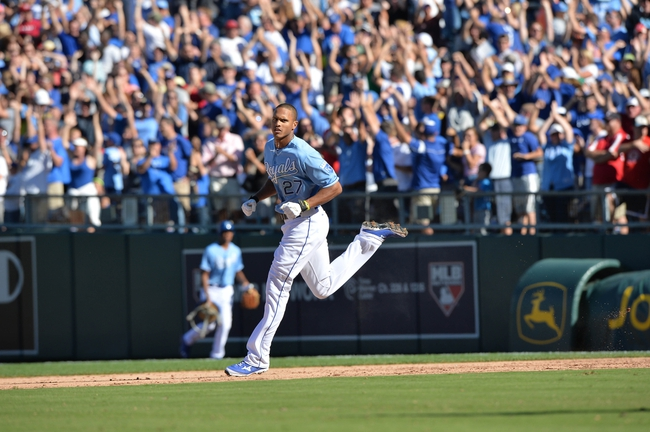 Sep 22, 2013; Kansas City, MO, USA; Kansas City Royals right fielder Justin Maxwell (27) celebrates after hitting a walk off grand slam against the Texas Rangers during the 10th inning at Kauffman Stadium. The Royals beat the Rangers 4-0. Mandatory Credit: Peter G. Aiken-USA TODAY Sports