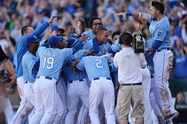 Sep 22, 2013; Kansas City, MO, USA; The Kansas City Royals celebrate after Justin Maxwell (center) hit a walk off grand slam  against the Texas Rangers during the 10th inning at Kauffman Stadium. The Royals beat the Rangers 4-0. Mandatory Credit: Peter G. Aiken-USA TODAY Sports