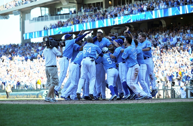 Sep 22, 2013; Kansas City, MO, USA; The Kansas City Royals celebrate after Justin Maxwell (27) hit a walk off grand slam against the Texas Rangers during the 10th inning at Kauffman Stadium. The Royals beat the Rangers 4-0. Mandatory Credit: Peter G. Aiken-USA TODAY Sports