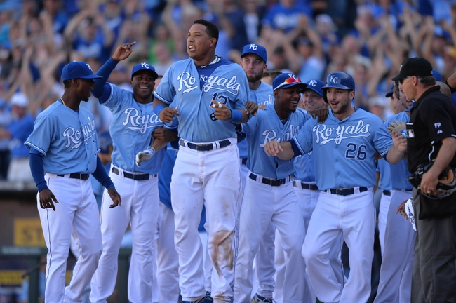 Sep 22, 2013; Kansas City, MO, USA; The Kansas City Royals celebrate after Justin Maxwell (not pictured) hit a walk off grand slam against the Texas Rangers during the 10th inning at Kauffman Stadium. The Royals beat the Rangers 4-0. Mandatory Credit: Peter G. Aiken-USA TODAY Sports