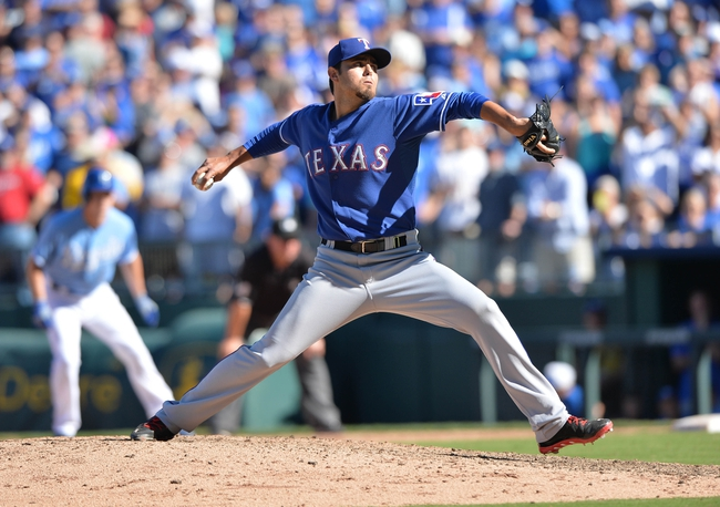 Sep 22, 2013; Kansas City, MO, USA; Texas Rangers pitcher Joakim Soria (28) delivers a pitch against the Kansas City Royals during the 10th inning at Kauffman Stadium. Mandatory Credit: Peter G. Aiken-USA TODAY Sports