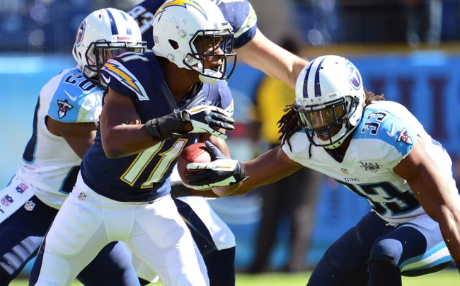 Sep 22, 2013; Nashville, TN, USA; San Diego Chargers wide receiver Eddie Royal (11) runs with the ball against Tennessee Titans safety Michael Griffin (33) during the second half at LP Field. The Titans beat the Chargers 20-17. Mandatory Credit: Don McPeak-USA TODAY Sports